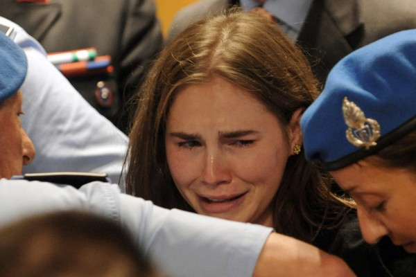 Amanda Knox cries after hearing the verdict that overturns her conviction and acquits her of murdering her British roomate Meredith Kercher, at the Perugia court, Italy, Monday Oct. 3, 2011.