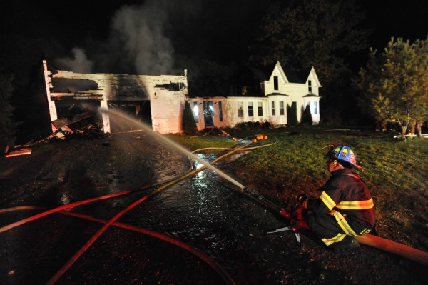 Dwight McIntosh, a public safety officer for the Levant Fire Dept., helps fellow firefighters douse the house fire that broke out around 6:40 pm on 427 Stetson Road West in Levant. Firefighters from Levant and the surrounding towns responded.