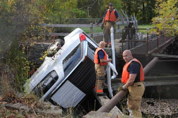 Lewiston public safety workers prepare to remove an SUV from a Lewiston canal Tuesday.