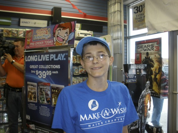 14-year-old Sam Alexander's smile lights up the room as he prepares for a shopping spree as part of his Make-A-Wish Foundation of Maine shopping spree.