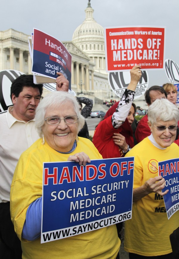 Sue Ward (left), of Upper Marlboro, Md., a member of the National Committee to Preserve Social Security and Medicare, joins members of Congress and union members on Capitol  Hill in Washington, Wednesday, Oct. 26, 2011, to voice opposition to potential cuts in Medicare, Medicaid, and Social Security benefits as the deficit supercommittee looks for cuts ways to reduce government spending in all areas.
