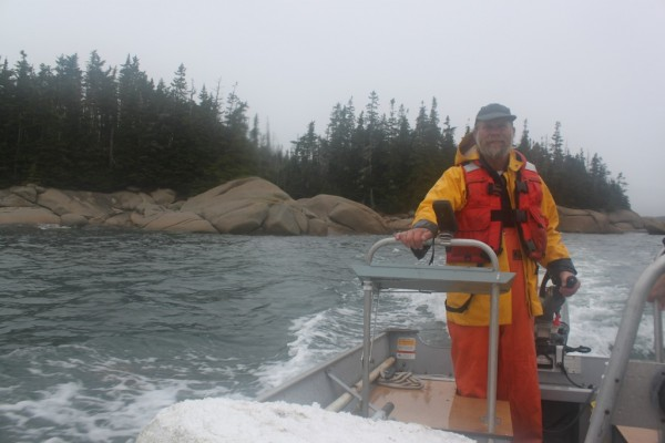 Henri Gignous leads a group of volunteers to seven islands on the Maine Island Trail in the archipelago off Stonington Oct. 1, 2011. Gignous has been a monitor skipper for MITA since its inception in 1987.