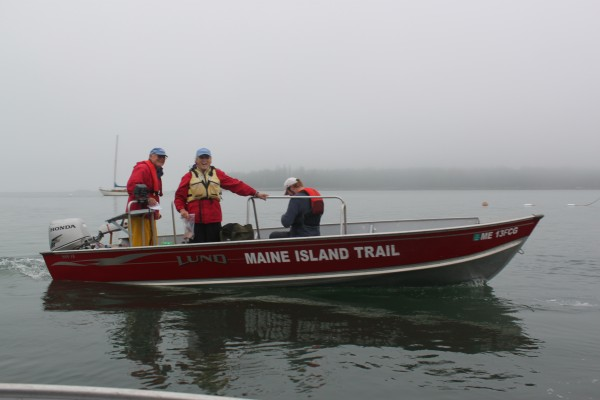 Volunteers for a fall Maine Island Trail cleanup prepare to leave Stonington for the day to clean islands of trash on Oct. 1, 2011.