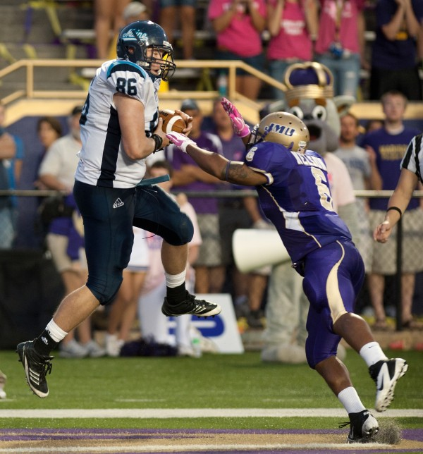 Maine tight end Justin Perillo grabs a touchdown pass as James Madison's Vidal Nelson defends in overtime at Bridgeforth Stadium Zane Showker Field in Harrisonburg, Va.. Maine quarterback Christopher Treister scored on a two-point conversion to give Maine the victory 25-24.