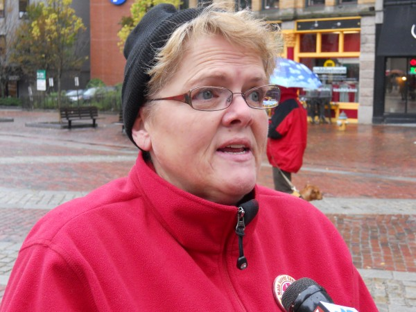 Cokie Giles, president of the board of the Maine State Nurses Association, fields questions from reporters Thursday afternoon in Monument Square. The Maine State Nurses Association joined the larger National Nurses United in supporting the Occupy movement Thursday, bringing supplies to the Occupy Maine encampment in Portland.