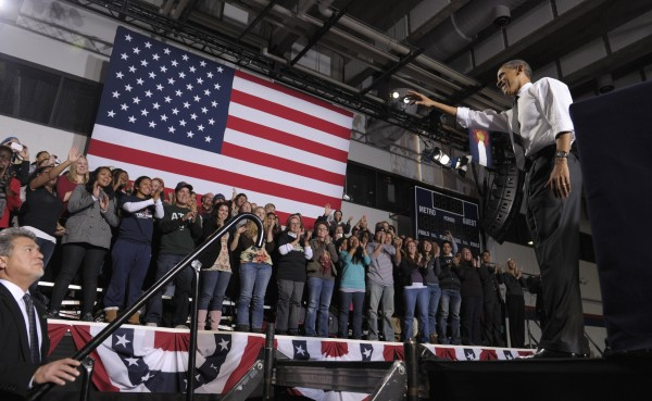 President Barack Obama waves to the crowd after speaking about managing student debt during an event at the University of Colorado Denver Downtown Campus in Denver, Wednesday, Oct. 26, 2011.