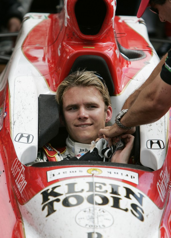 Dan Wheldon, of Great Britain, arrives in Victory Circle after winning the 89th running of the Indianapolis 500 at Indianapolis Motor Speedway in Indianapolis in May 2005. Wheldon died Sunday, Oct. 16, 2011 in a fiery 15-car wreck at Las Vegas Motor Speedway when his car flew over another on Lap 13 and smashed into the wall just outside turn 2. He was 33.