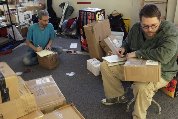 Occupy Wall Street protesters open packages sent to the protesters in New York on Wednesday, Oct. 26. Since the protests began on Sept. 17, protesters at the Zuccotti Park encampment say they have received about 100 letters a day.
