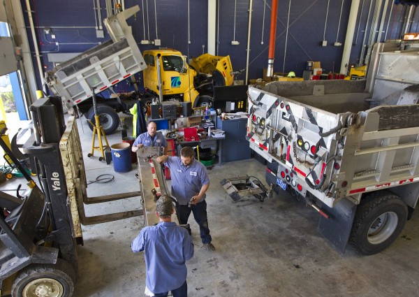 Curtis Dague (back), Harry Grafmyer (center) and Jeremy Coy attach a salt spreader on a truck at the PennDOT Cumberland County facility in preparation for the coming snowstorm, Friday, Oct. 28, 2011 in Carlisle, Pa.