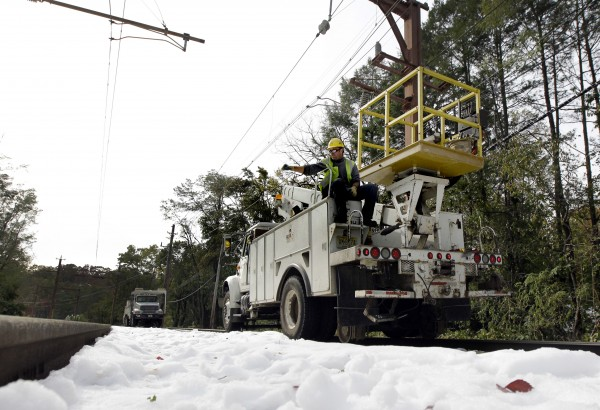 A utility truck makes its way along a rail line that was interrupted by a rare October snowstorm, Monday, Oct. 31, 2011, in Millburn, N.J.