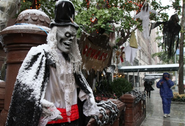 Outdoor Halloween decorations get covered with snow as it falls Saturday Oct. 29, 2011 in New York.  A classic nor'easter is moving along the East Coast and is expected to dump anywhere from a dusting of snow to about 10 inches throughout the region starting Saturday.