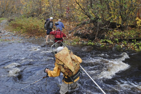 Volunteers with the Maine Appalachian Trail Club cross a rain swollen Hay Brook near the Appalachian Trail last Saturday. They were hiking in to pack out the ridge runner for the club, Krisdin Diehl.