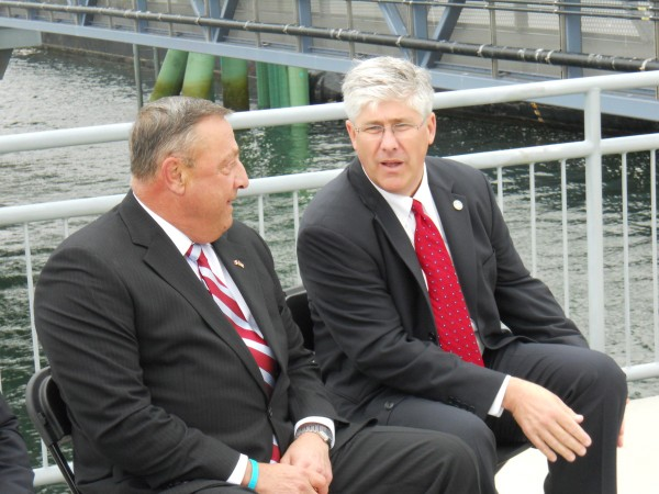 Gov. Paul LePage and Portland Mayor Nicholas Mavodones chat just before the start of a ceremony Wednesday celebrating the opening of Portland's Ocean Gateway Pier II.