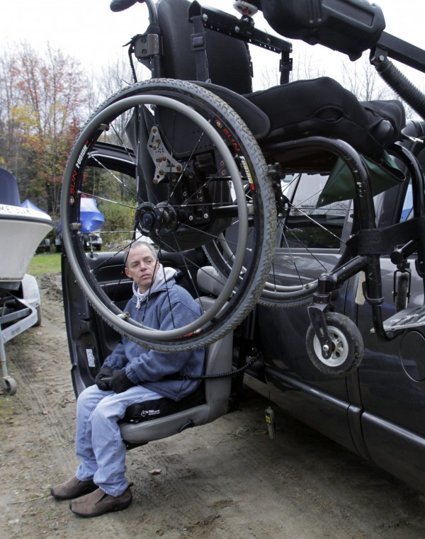Nick Masi III maneuvers his wheelchair into his vehicle after checking on his damaged boat at a boatyard in Arundel on Wednesday, Oct. 26.
