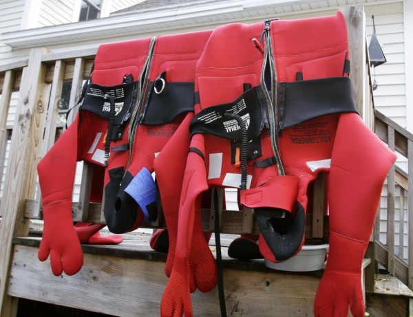 Survival suits are hung over the porch of paraplegic skipper Nicholas Masi III's house in Biddeford, Maine on Monday, Oct. 3, 2011.