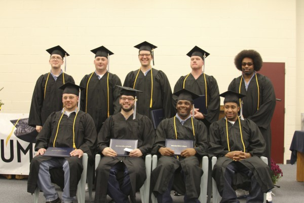 Nine inmates graduated with associate and bachelor's degrees from an in-prison college program on Wednesday. Top row, from left: Christopher Shumway, Shaun Libby, Ryan Currier, Jon Dyer, Joseph Jackson. Bottom row, from left: Steven Lewicki, Shaun Tuttle, Foster Bates, Edwin Keys.