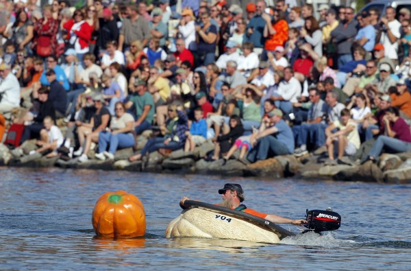 Tom Lishness motors around the race course during the Damariscotta Pumpkinfest and Regatta, an event that drew several hundred spectators.