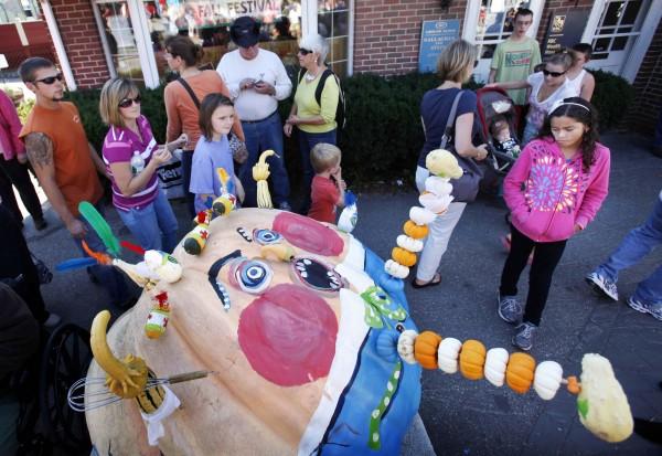 A Humpty Dumpty pumpkin appears to have fallen onto a downtown sidewalk at the Damariscotta Pumpkinfest.