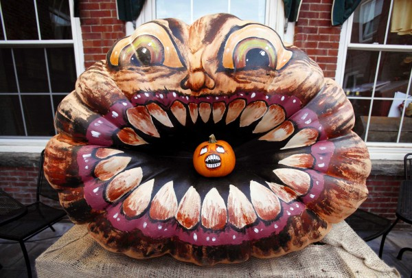 A giant painted pumpkin appears ready to chomp down on a smaller pumpkin the Damariscotta Pumpkinfest. Dozens of highly decorated pumpkins were on display throughout downtown.