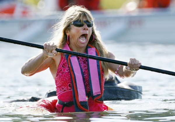 Ja Ja Martin of Bremen lets out a yell as the pumpkin she was paddling sinks into the chilly water during the Damariscotta Pumpkinfest and Regatta.