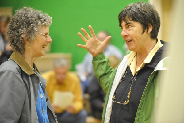 Kathy Johnson (left) North Woods Project Director for the Natural Resources Council of Maine talks with Roxanne Quimby before Thursday evening's National Park Service feasibility study meeting at Schenck High School in East Millinocket.