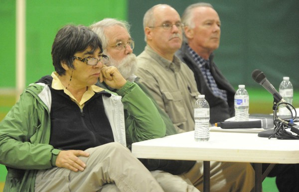 Roxanne Quimby (from left); Bob McIntosh, a retired national park official; Mark Leathers, land manger for Eliotsville Plantation; and Dan O'Leary, CEO of Eliotsville Plantation listen to a citizen's question during a National Park Service feasibility study meeting at Schenck High School in East Millinocket.