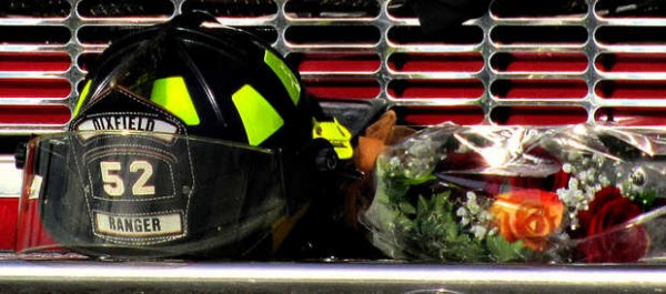 Dani Ranger's firefighter helmet sits on the front of the Dixfield Fire Co. ladder truck during her funeral procession Friday. The helmet was a Christmas gift from her cousin and mentor, Dixfield fire Capt. Jason Hyde.