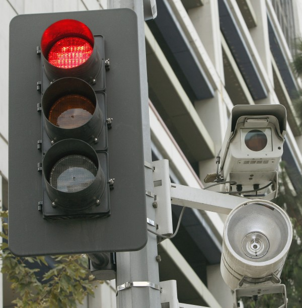 One out of every five American lives in a community that outsources its enforcement of traffic violations caught by red light cameras to private vendors, according to a report by a consumer advocacy group. In many cases, those vendors a direct financial incentive to issue more tickets and to try to block alternative means of traffic enforcement.