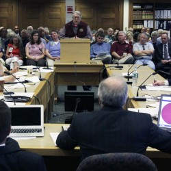 Mainers testify before the Reapportionment Commission at the State House in Augusta, Maine, on Tuesday, Aug. 23, 2011.