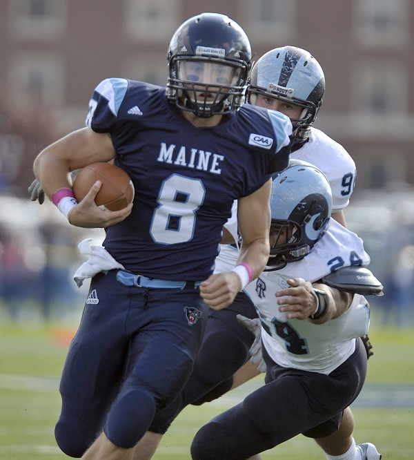 Maine quarterback Warren Smith (8) scrambles away from Rhode Island's Dave Zocco (24) and James Timmins (96) during the first half of an NCAA football game in Orono, Maine, Saturday, Oct. 15, 2011.