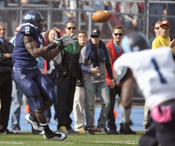 Maine's Pushaun Brown (2) makes a reception from quarterback Warren Smith during the first half of an NCAA college football game against Rhode Island, in Orono, Maine, Saturday, Oct. 15, 2011.