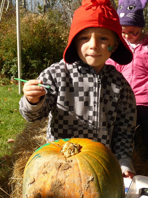 Harley Avery, 5, of Lubec, paints a pumpkin Saturday morning during the annual Rice Fest at Cobscook Community Learning Center in Lubec. The three-day festival culminated Saturday and was established to honor the memory of Wayne and Lorraine Rice, dedicated volunteers who were killed in January 2010 in a Route 9 car crash.