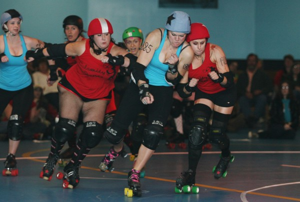 The Stone Quarry Vixens' Bristol Smashin (center) collides with Crazy Buchanan (right) of the Calamity Janes as Cherry Clobber (left) approaches during a Maine Roller Derby event Saturday.