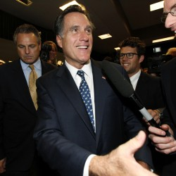 Romney's practical pitch may trump Perry's bluster