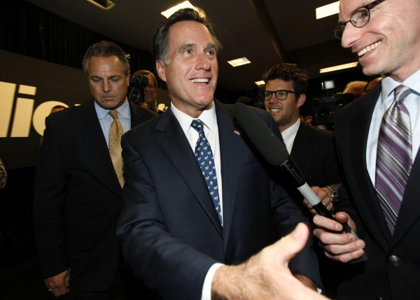 Republican presidential candidate and former Massachusetts Gov. Mitt Romney shakes hands after speaking at Microsoft headquarters Thursday, Oct. 13, 2011, in Redmond, Wash.