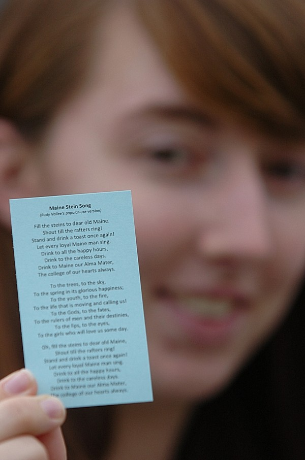 Senior Hannah Hudson of Columbia Falls, president of the All Maine Women, a campus honor society, holds up a copy of the &quotMaine Stein Song&quot that she and others handed out on campus Wednesday afternoon, Oct. 12, 2011.