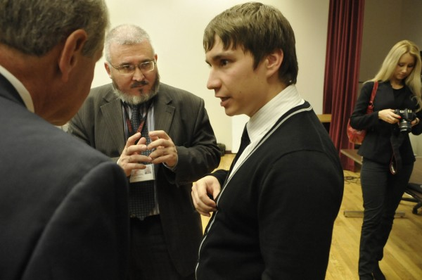 Alexey Mikhailov (center), head of the Department of Public Relations for the Siberian State Aerospace University, chats with Rand Erb (left), Director of Gifts for Husson University, and Yury Nabokov (right), one of his former students who is now a senior at the New England School of Communications. On the far right (in background) is Maria Nabokov, Yury Nabokov's wife.