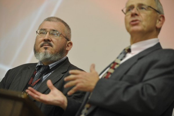 Thomas C. Johnston (right) president of the New England School of Communications, introduces Alexey Mikhailov (left), head of the Department of Public Relations for the Siberian State Aerospace University. Mikhailov addressed the Husson University community Wednesday afternoon, Oct. 26, 2011.