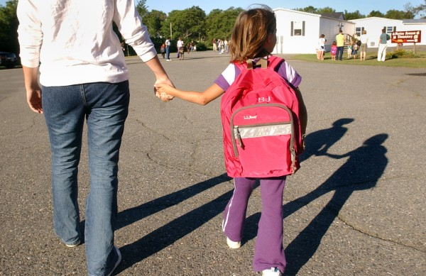 Meredith Jordan walks her little sister Brittney, 7, to her class on the first day of school at Morton Avenue School in Dover-Foxcroft in 2002.