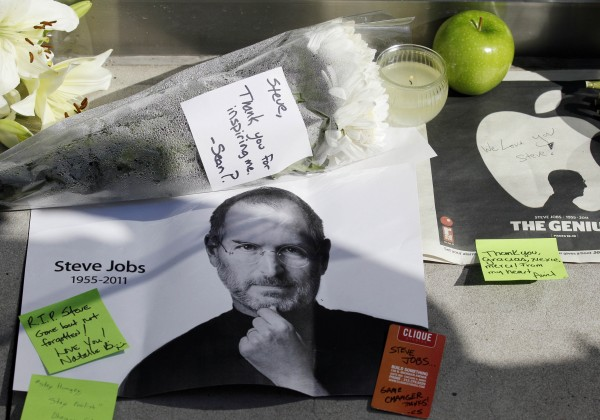 Flowers, apples and notes are displayed in tribute to Steve Jobs outside of an Apple store in Chicago, Thursday, Oct. 6, 2011. Jobs, the Apple founder and former CEO who invented and masterfully marketed ever-sleeker gadgets that transformed everyday technology, from the personal computer to the iPod and iPhone, has died. He was 56.