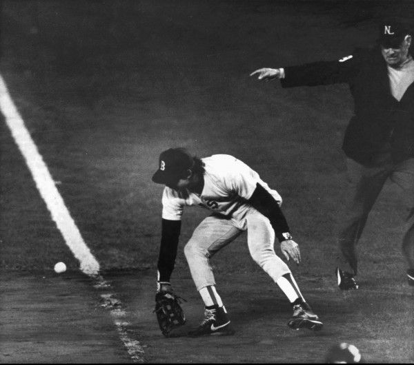 Boston Red Sox first baseman Bill Buckner misplays the ball during Game 6 of the World Series against the New York Mets on Oct. 25, 1986.