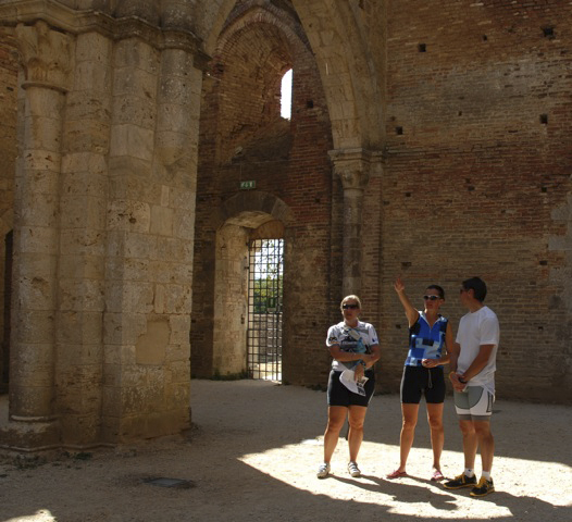 Fresh Trails riders Lori Wilson (left), Lise Collins and Scott Walton spend some time exploring the ruins of the Abbey of San Galgano in Tuscany.