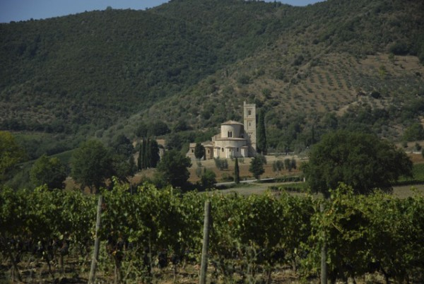 The Abbey of San Antimo is surrounded by the Tuscan hills and vineyards that produce the world's Brunello wine.