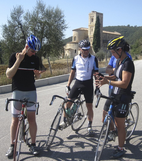 Fresh Trails cyclists Dave Chamberlain (left), Mark Rossignol and Tricia Martin discuss the ride's itinerary before leaving the Abbey of San Antimo.