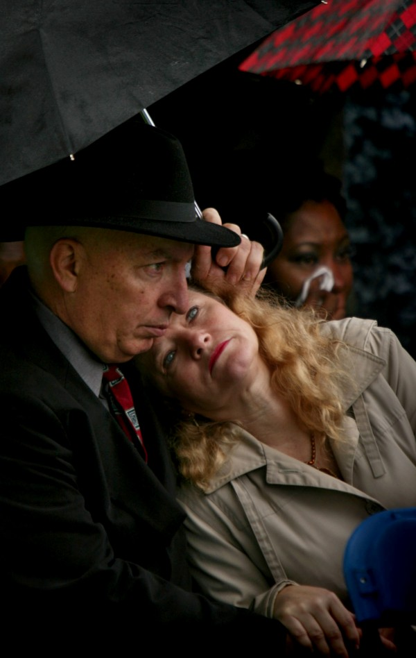 Jan Abney lays against her husband, Paul Abney, during the USS Cole 11th Anniversary Remembrance Ceremony at Norfolk Naval Station on Wednesday, Oct. 12, 2011, in Norfolk, Va.
