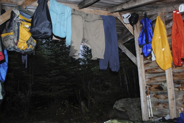 Wet clothes hang from the line in lean-to number two at Chimney Pond Campground last Monday. Although located in the Great Basin at around 2,900 feet at the base of Mount Katahdin, the view out the front of the lean-to was mostly gray, due to a persistent weather front.