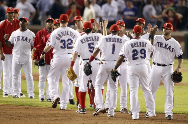 The Texas Rangers react after winning Game 5 of the World Series 4-2 over the St. Louis Cardinals on Monday, Oct. 24, 2011, in Arlington, Texas. The Rangers take a 3-2 lead in the series.