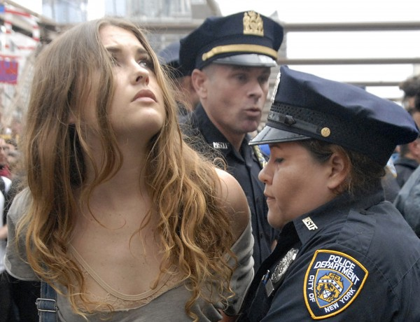 In this Oct. 1, 2011 photo, police arrest a protester on New York's Brooklyn Bridge during Saturday's march by Occupy Wall Street. Protesters speaking out against corporate greed and other grievances attempted to walk over the bridge from Manhattan, resulting in the arrest of more than 700 during a tense confrontation with police. The majority of those arrested were given citations for disorderly conduct and were released, police said.