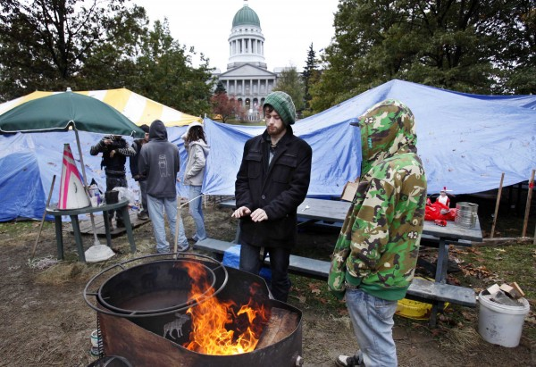 Occupy Maine members gather in Capitol Park on a damp and chilly morning across from the State House, Thursday, Oct. 20, 2011, in Augusta. About 20-30 people have been camping in the state-owned park.