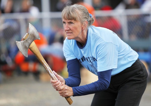 Brenda Stevens, 58, of Castleton, Vt., takes aim in the axe throwing competition Woodman's Field Day at the Fryeburg Fair. &quotIf you're frustrated, this is a good tension release,&quot she said.